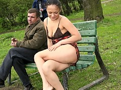 Young ho poses naked next to two bums in the park