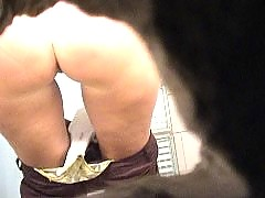 Sporty bitch with hot ass takes a leak on spy cam